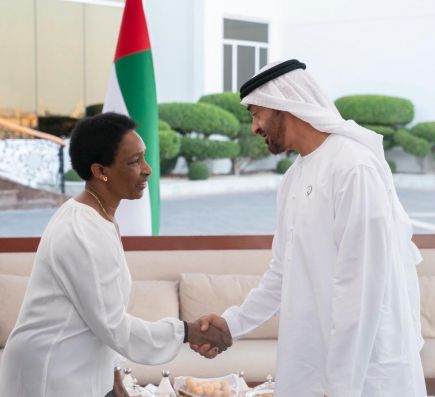 Loretta shaking hands with the Crown Prince of Abu Dhabi